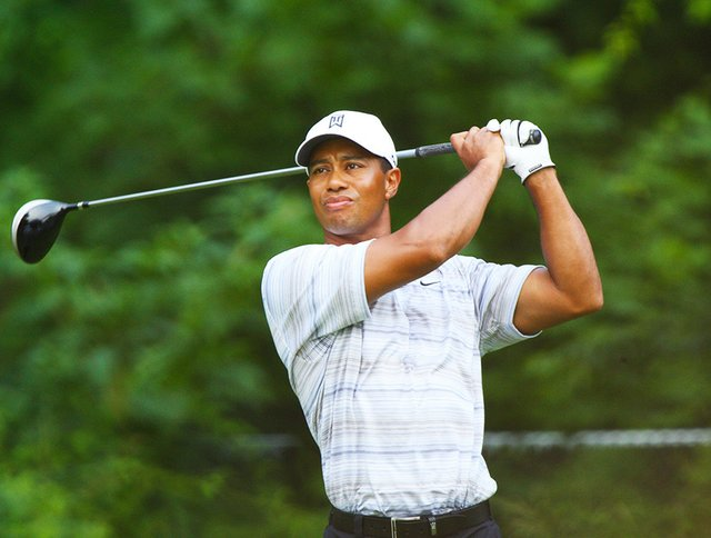 Tiger_Woods_drives_by_Allison.jpg