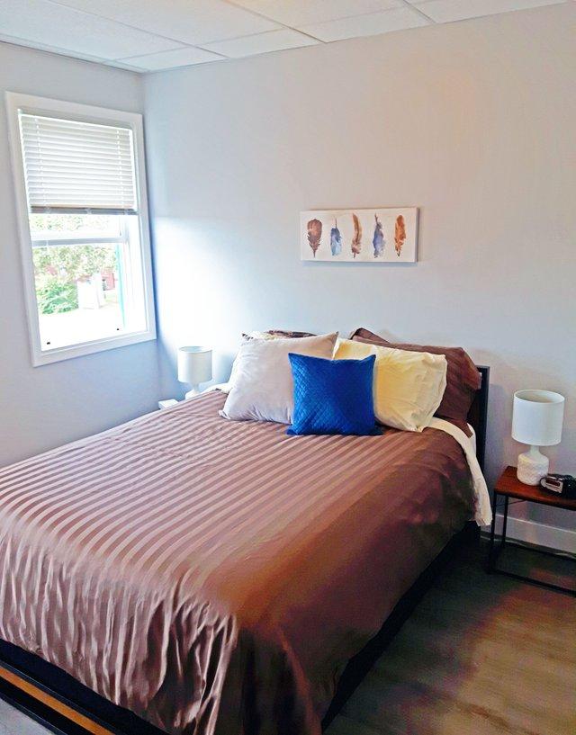 Upper Attic Suite -  master bed.jpg
